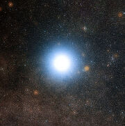 The bright star Alpha Centauri and its surroundings