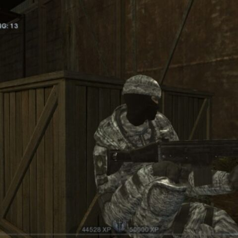 A player character takes cover with his SCAR-H CQC. Note the stock which gives it away as the first generation SCAR-H.