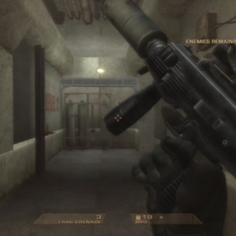 The MP9 being reloaded in R6V1. This MP9 is fit with a reflex scope and a suppressor.