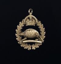 Golden Castor Charm