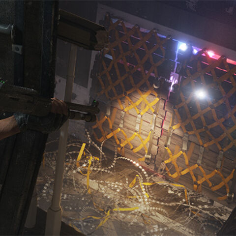 A promotional screenshot featuring the old barricade design