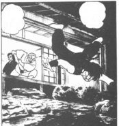 Genma throwing Ranma