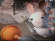 Rabbid is holding a wrench