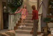 Kyra comes down the stairs