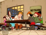 The gang laughing and Spinelli being angry during lunch