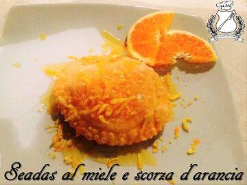 Gran-Consiglio-della-forchetta-Seadas-al-miele-e-scorza-di-arancia-m