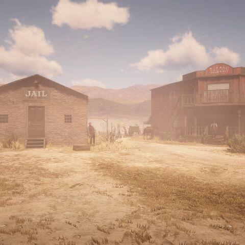 Das Gefängnis und der Saloon im Ort in Red Dead Redemption 2