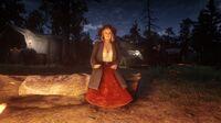 Karen Jones singing at the campfire in Horseshoe Overlook