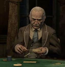 Nigel playing poker