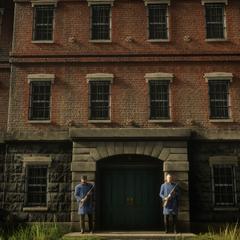 Le premier bâtiment gardé par deux gardes