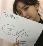 Seulgi holding a paper with her signature