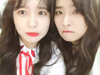 Yeri and Seulgi taking a selfie looking scared