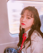 Yeri sitting by a train window