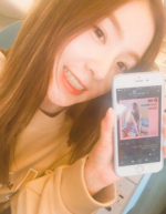 Irene holding up her phone