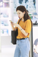 Seulgi on her phone