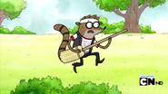 1000px-Rigby holding broom