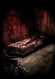 Lisa Trevor restrained to bed