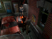 Resident Evil 3 Nemesis screenshot - Uptown - Street along apartment building - Jill Valentine gameplay 02