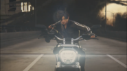 Leon in the motorcycle after killing Cerberus
