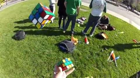 Solving three cubes while juggling them