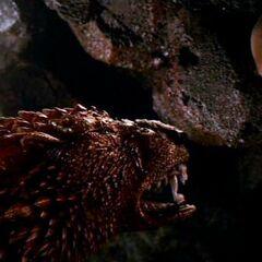 Hellhound staring down Riddick.
