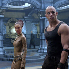 Dame Vaako escorting Riddick down one of the many corridors of the Necropolis