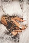 Rihanna hand tattoo