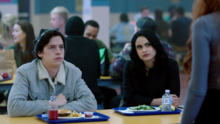 Season 1 Episode 13 The Sweet Hereafter Veronica and Jughead greeted by Cheryl.PNG