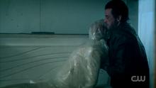 Season 1 Episode 12 Anatomy of a Murder FP putting body in freezer