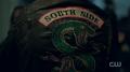 Season 1 Episode 13 The Sweet Hereafter Jughead's Serpent jacket.png