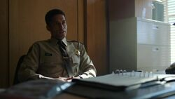 RD-Caps-2x22-Brave-New-World-57-Sheriff-Michael-Minetta