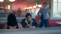 Season 1 Episode 8 The Outsiders Archie walks toward the gang