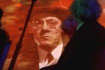 Slugworth appearing in the tunnel of terror scene, shocking Charlie and Grandpa Joe