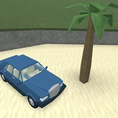 A new palm tree as well as a car that resembles a Rolls-Royce or a Mercedes.