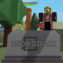Two players on top of the Union Square sign.