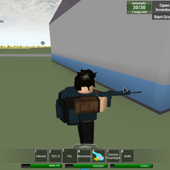 A survivor wearing a black mili and FAL