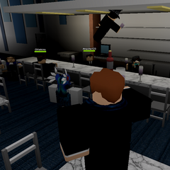 An attendee projectile impales the roof of the bar.