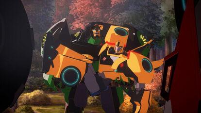 TrustExercises Grimlock holds Bumblebee