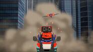 Laserbeak chasing Optimus Prime
