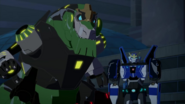 Grimlock and Strongarm Beat Boostwing