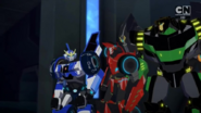 Strongarm, Grimlock, and Sideswipe in the High Council chambers.