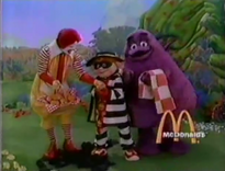 Ronald and Grimace share fries with Hamburglar