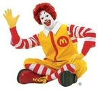 Ronald McDonald wave legs crossed