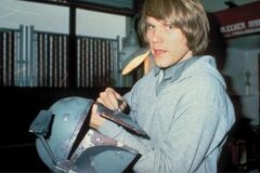 Joe Johnston with helmet of Boba Fett