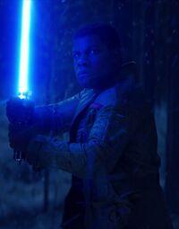Finn with lightsaber