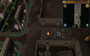 Scan clue Dorgesh-Kaan upper level east, outside large rectangular empty building