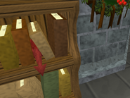 Imp hiding in bookshelf