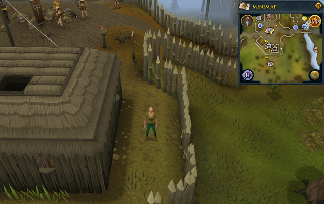 File:Compass clue Edgeville east of building with potter's wheel in Barbarian Village.png