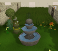 Large fountain in formal garden.png
