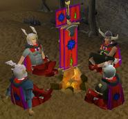 United Heros around a campfire